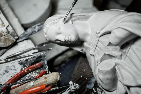 Gianluca working on a Mary statue.