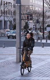 Japanese girl on bicycle