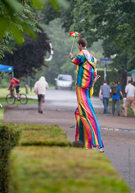 #87423,  Clown on stilts, Party in the Park, Woking, Surrey, 2012.