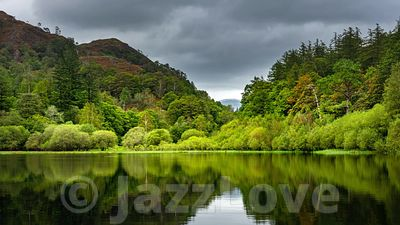 Clouds rolling over Yew Tree Tarn in Lake District.