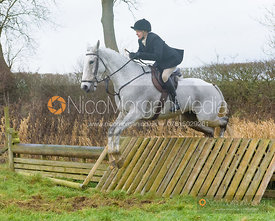 Margo Sly jumping a hunt jump after the meet