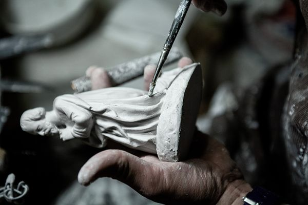 Some gypsum plaster is added to any tiny holes in the statue.