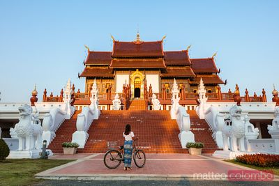 Woman with bicycle at Royal park Rajapruek, Chiang Mai, Thailand