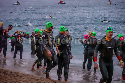 Sunrise as the swimmers enter the water prior to the Ironman Triathlon