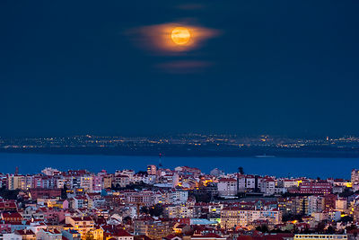Golden Moonrise above the City of Lisbon