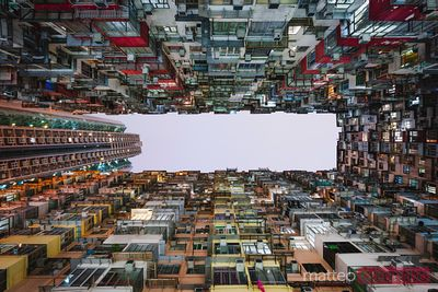 Low angle of densely packed apartment block, Hong Kong