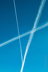 #71833,  Contrails or water condensation trails from an aircraft's jet engines, high above the Southeast of England.