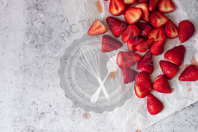 Halved Strawberries On Parchment Paper