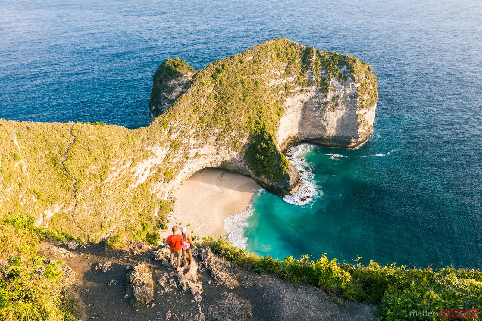 Couple standing near Kelingking beach, Nusa Penida, Bali