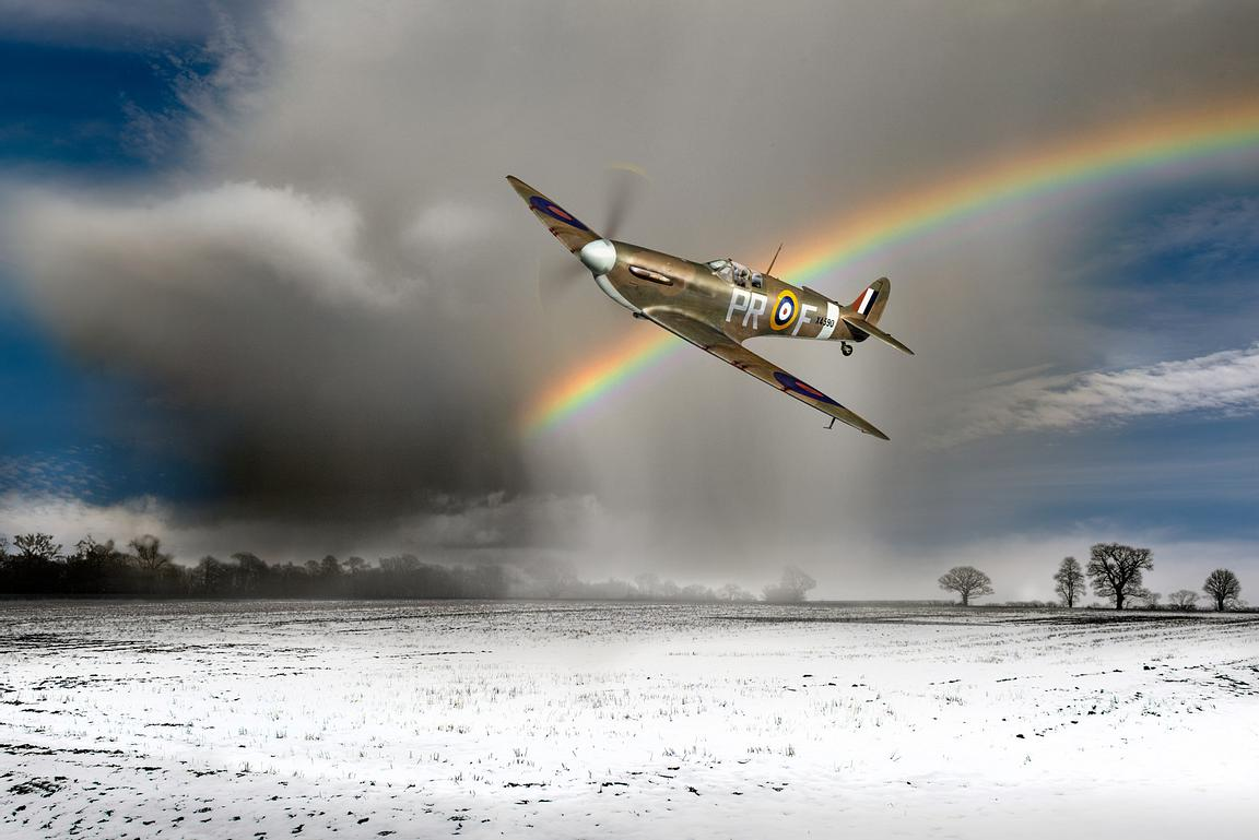Spitfire with snow shower rainbow