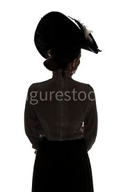 A Silhouette of an Edwardian woman in a big hat – shot from eye-level.
