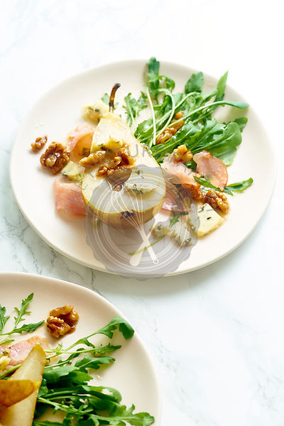 Pear salad with walnuts, prosciutto, arugula and blue cheese