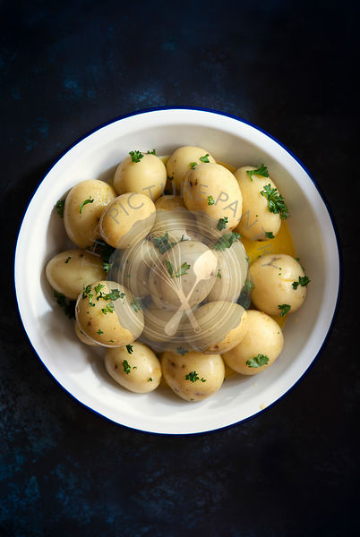 Whole potatoes with parsley and butter.