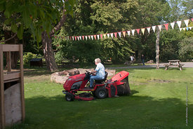 #73081,  Cutting the grass, Summerhill School, Leiston, Suffolk. The school was founded by A.S.Neill in 1921 and is run on de...