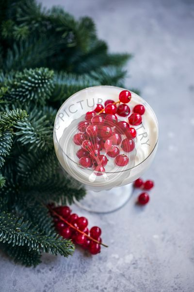 Yogurt and redcurrant in a glass