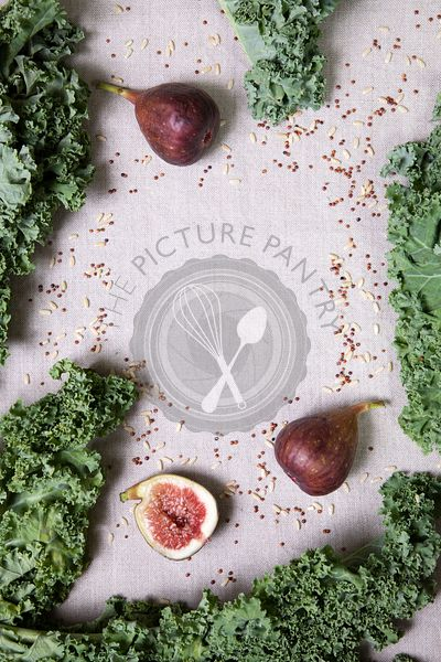 Figs, kale and rice on a grey background
