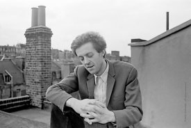 #74840,  Cornelius Cardew (1936-1981), avant-garde musician and composer, on the rooftops, Fitzrovia, London.  3rd July 1970.
