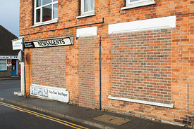 #70697,  Bricked up windows and doors, newsagents shop, New Romney, Kent, 2006.