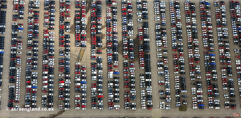 new cars awaiting delivery at the Nissan car plant in  Sunderland from the air