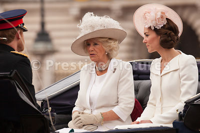 Catherine, Duchess of Cambridge riding with Camilla, Duchess of Cornwall and Harry, Prince Henry of Wales to the Trooping the...
