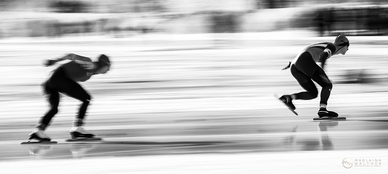 Two speed skaters at the Olympic Youth Games in St. Moritz, Switzerland.