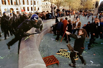 rioter squirts paint at police