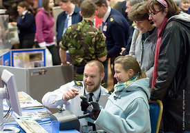 #29179  Trying out the flight simulator on the Royal Navy stand, Surrey Skills Festival, Sandown Park