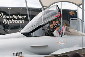 #052304,  A father sits in the cockpit of a Eurofighter Typhoon at the Farnborough International Airshow  2009.
