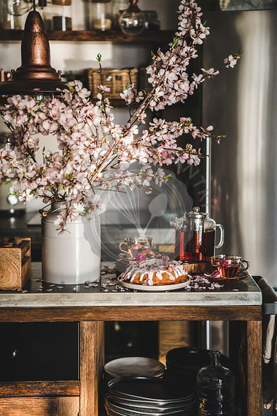Rose and almond gluten-free bundt cake with flowers and tea
