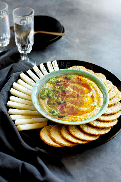 Spicy White Bean Dip served with jicama and crackers