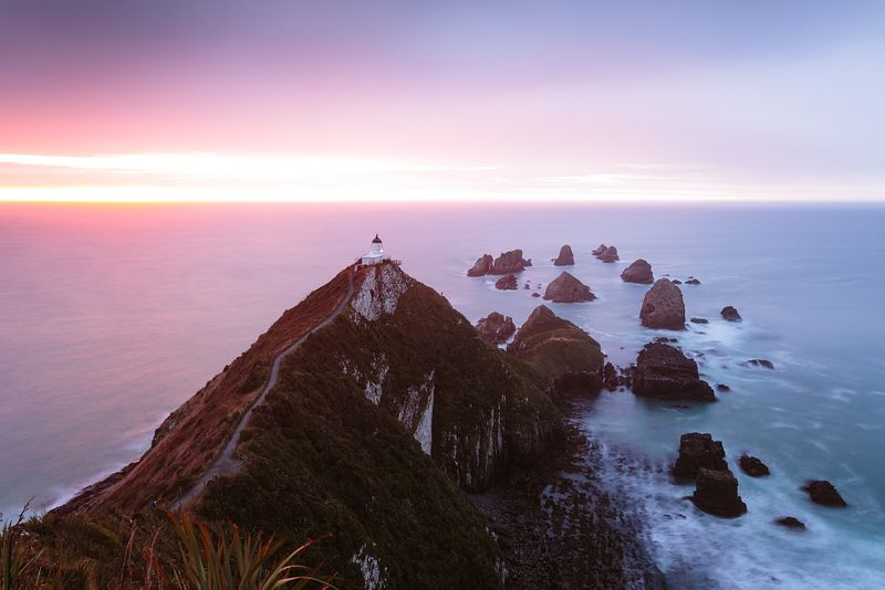 Nugget point lighthouse at dawn, Otago, New Zealand
