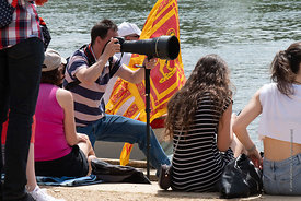 #124952,  Long lens photographer.  The 'Summer Eights', a week of rowing races for the Oxford University Colleges on the rive...