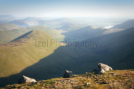 Views of Ramps Gill valley with The Nab to the left and Martindale Common in the distance from the summit of Rampsgill Head i...
