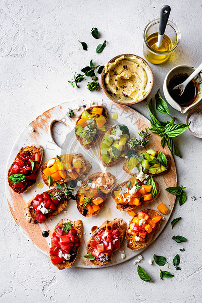Heirloom tomato bruschetta on a wooden platter.