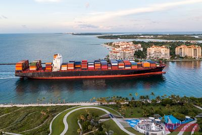 Cargo ship with containers arriving in Miami, USA