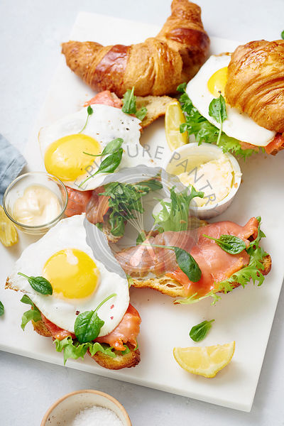 Croissants with fried egg and smoked red fish