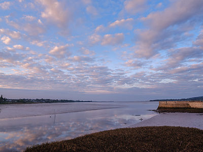 Calm dawn scene of River Clyst as it joins the Exe estuary at Topsham, Devon, UK