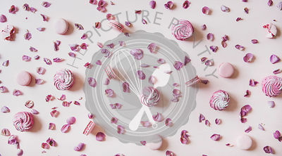 Flat-lay of macaron cookies, marshmallows and petals over pink background