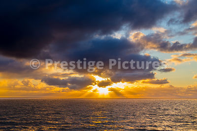 Sunset over the North Sea with Rays Radiating though Dark Clouds
