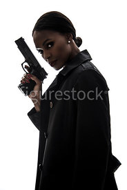 A tough woman, standing, in silhouette – shot from eye level.