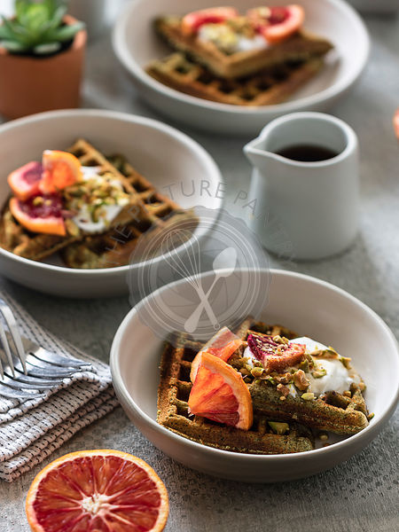 Spinach waffles with ricotta, blood oranges and pistachios