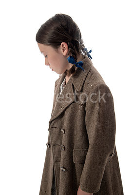 A 1940's child evacuee, in a big coat – shot from mid level.