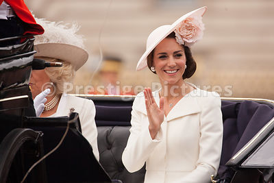 Catherine, Duchess of Cambridge smiles and waves as she rides in an Open Carriage to the Trooping the Colour Ceremony from Bu...