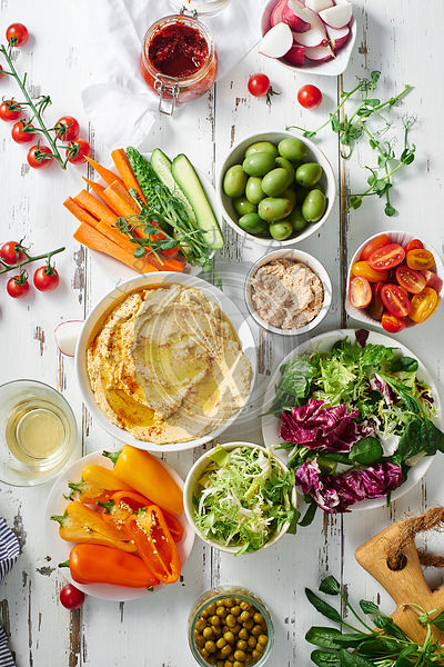 Hummus dip and raw vegetarian snacks