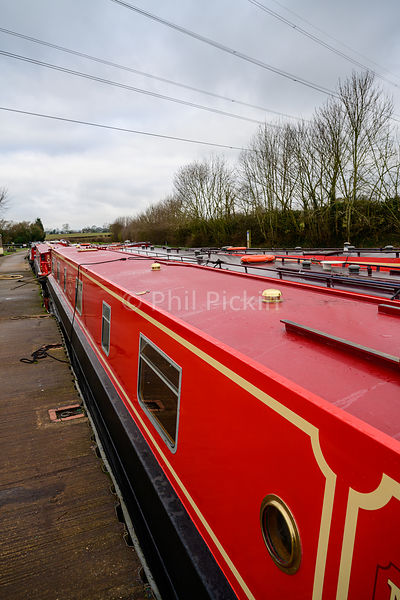 Whittington Wharf hire boat fleet moored up in winter.