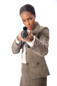 A blurred woman, standing, holding a shotgun – shot from eye level.