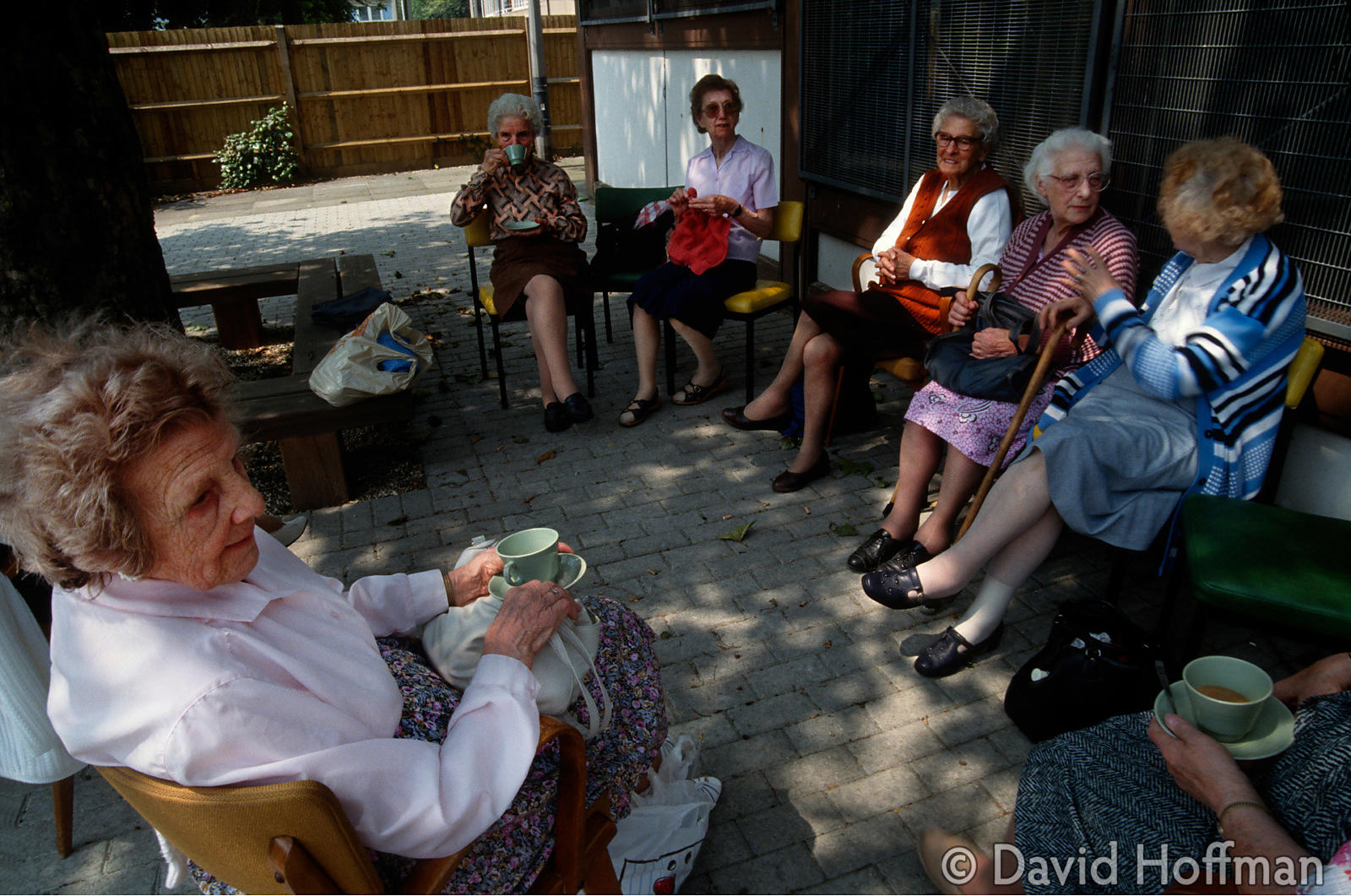 Elderly women chatting outside a council run day centre in Hackney.