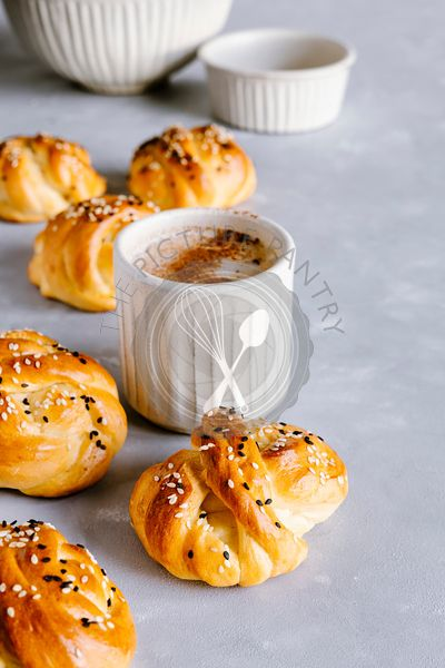 Vanilla knot buns with sesame and coffee cappuccino.