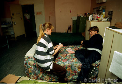 Prisoners play cards in their bedroom at H M Prison, Holloway, London.