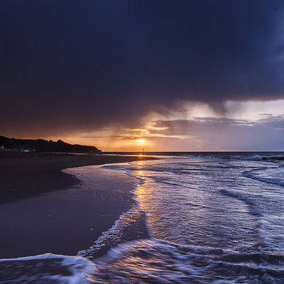 Sunrise_under_rainclouds_-_Exmouth